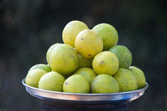 Heap of Lemons in Plate Stock Photography