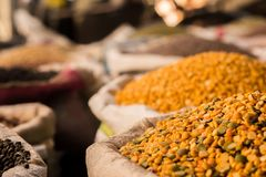Heap of lentils in sacks at a grocery shop royalty free stock photo