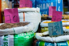 Heap of lentils in sacks at a grocery shop stock images