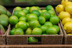 Heap limes in wicker crate. Heap limes in store wicker crate Stock Photography