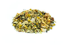Heap of loose mixture of herbal tea on white background. Heap of loose mixture of herbal tea isolated on white background Royalty Free Stock Image