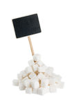 Heap of  lump sugar  with a pointer for your text Royalty Free Stock Photography