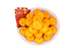 Heap of mandarin oranges, red packets with good luck character Stock Photography