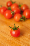 Heap of many small red ripe cherry tomatoes Stock Photo