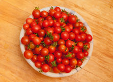 Heap of many small red ripe cherry tomatoes Royalty Free Stock Image