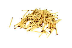 Heap of many wooden matches macro or close up  with black ends isolated on white Royalty Free Stock Photos