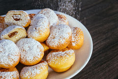 heap of marmalade filled bismarck donuts on white plate royalty free stock image
