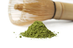 Heap of matcha tea and a whisk Stock Image