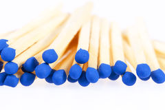 Heap of matches with blue heads isolated on white background Royalty Free Stock Image