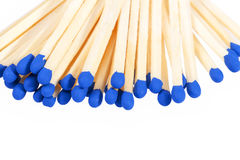 Heap of matches with blue heads isolated on white background Royalty Free Stock Photography