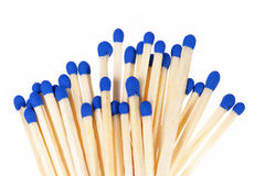 Heap of matches with blue heads isolated on white background Stock Photo