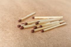 Heap of matches on brown craft paper. Closeup stock images