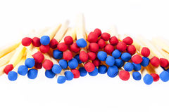 Heap of matches with red and blue heads isolated on white background Stock Photography