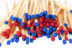 Heap of matches with red and blue heads isolated on white background Stock Image