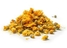 Heap of medicinal flowers of a calendula on white background. Herbal tea. Close up. High resolution Royalty Free Stock Photos