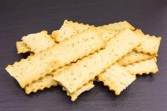 Crispy mediterranean cracker. Heap of mediterranean crunchy cracker with rosemary stock images