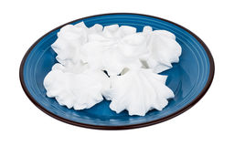 Heap of meringue in blue glass plate isolated on white Stock Images