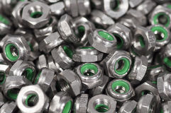 Heap of metal nuts with green interior Stock Photos