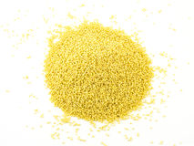 Heap of millet isolated on white background.  stock photos