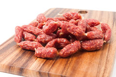 A heap of mini Salamis on wooden board Stock Photography