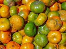 A heap of mixed mandarin oranges stock photo