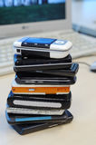 Heap of mobile phones. With computer background. all kinds of brands Royalty Free Stock Image