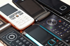 Heap of mobile phones. All kinds of brands Royalty Free Stock Photography