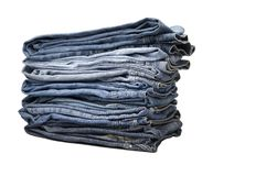 Heap of modern designer blue jeans Royalty Free Stock Photo