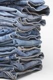 Heap of modern designer blue jeans Royalty Free Stock Photography