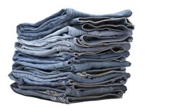 Heap of modern designer blue jeans Stock Photos