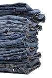 Heap of modern designer blue jeans Royalty Free Stock Image