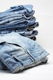 Heap of modern designer blue jeans Stock Photography
