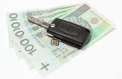 Heap of money with car key on white background Stock Images