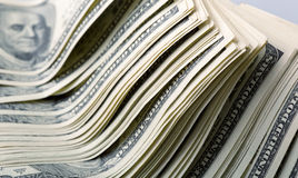 Heap of money Stock Images