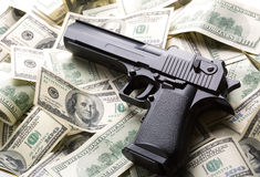 Heap of money and handgun Royalty Free Stock Image