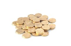 Heap of Money. A pile of golden-colored one pound English coins Royalty Free Stock Images