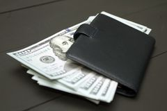 Heap of money and wallet. Dollars money cash on black background. Heap of money and wallet Royalty Free Stock Photography