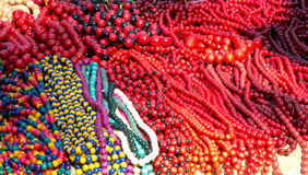 Heap of the motley beads. Large stack of the varicolored wooden necklaces stock images