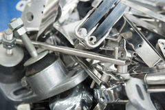 Heap of mounting hardware on stand close up Stock Photos