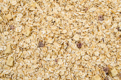 Heap of muesli with apple and cherry, close up.  Delicious granola cereal mix, with dried fruit and seeds Royalty Free Stock Photography