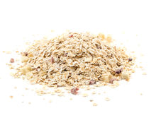 Heap of muesli with apple and cherry, isolated on white. Delici. Ous granola cereal mix, with dried fruit and seeds stock image