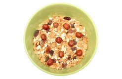 Heap of muesli with hazelnut in green bowl Stock Photography