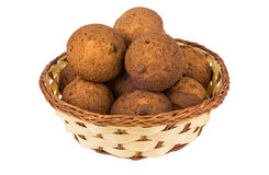 Heap of muffins in wicker basket  on white Stock Photos