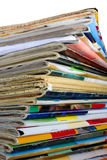 Heap of multi-coloured old magazines. On a white background it is isolated Stock Photo
