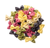 Heap of multicolor uncooked farfalle pasta Royalty Free Stock Image