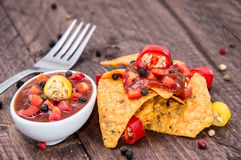 Heap of Nachos with Salsa Sauce Stock Photography