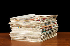 Heap of newspapers on a wooden table Stock Photos