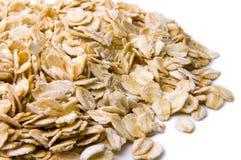 Heap of oat flakes closeup (gray shade) Royalty Free Stock Image