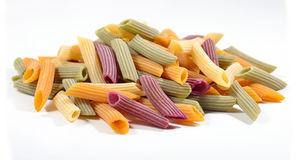 Free Heap Of Colored Uncooked Italian Pasta Penne On A White Stock Images - 73368784