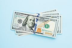 Free Heap Of Hundred Dollars. Modern 100 Us Dollar Bills On Blue Background Royalty Free Stock Photography - 141981917